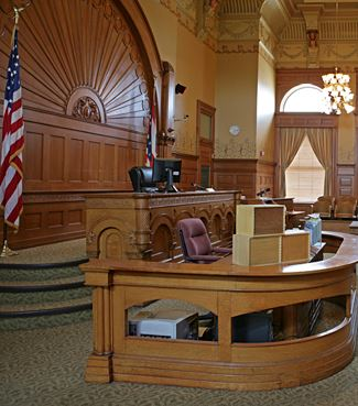 A courtroom, viewing the judge's bench